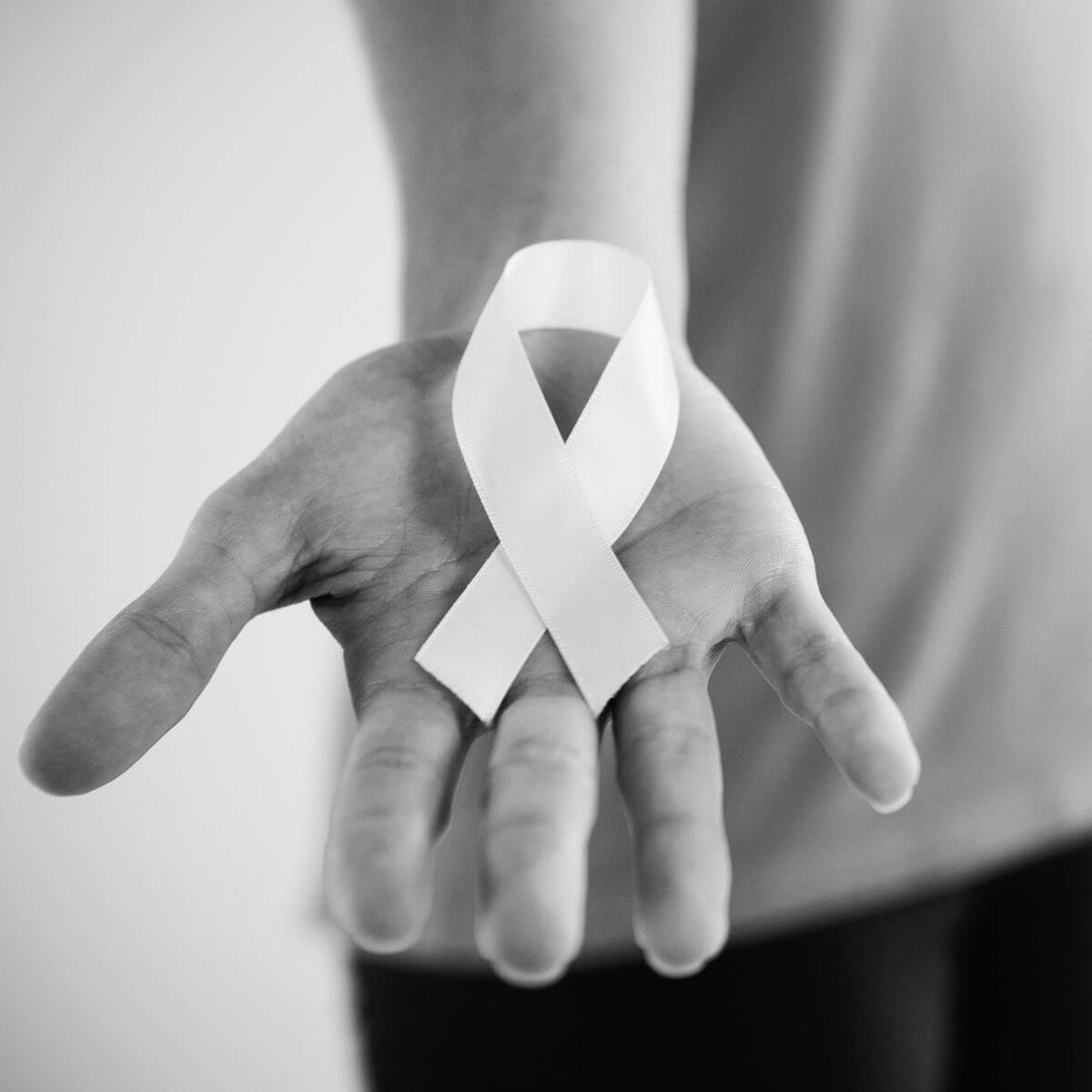 Cancer ribbon in hand